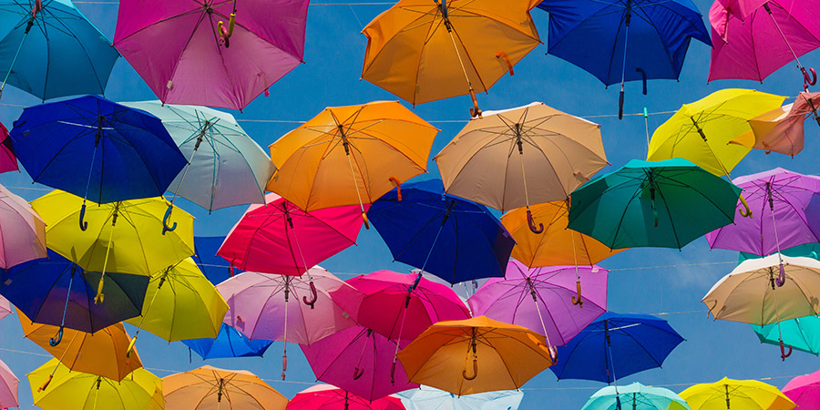 Colorful umbrellas on the sky